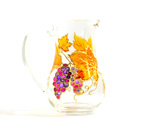 Autumn leaves and grapes pitcher